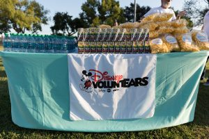 Water and Snacks ready for distribution on a table at Summer Movie Night park